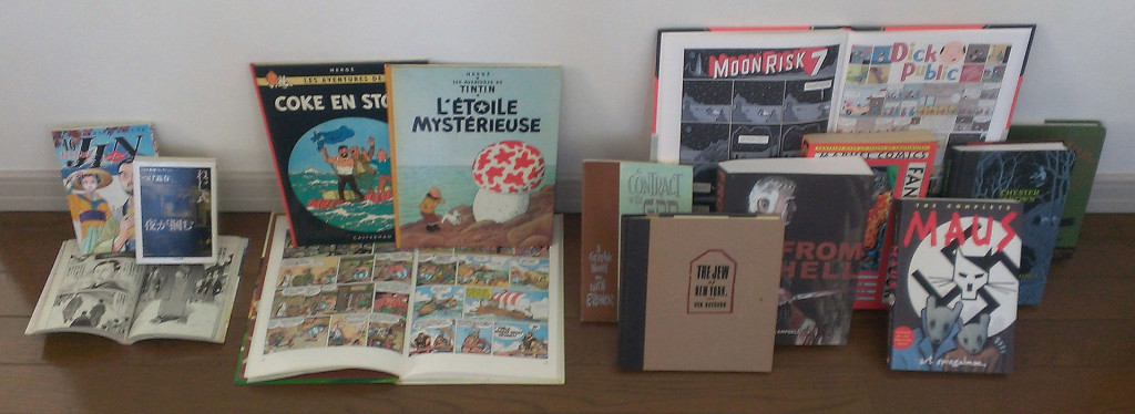 """A comparison of book formats for comics around the world. The left group is from Japan and shows the tankōbon and the smaller bunkobon formats. Those in the middle group of Franco-Belgian comics are in the standard A4-size comic album format. The right group of graphic novels is from English-speaking countries, where there is no standard format."" Curly Turkey CC BY-SA 3.0"